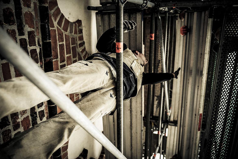 Handwerker Bauhütte bei der Arbeit auf dem Gerüst - Copyright: Thorsten Wulff