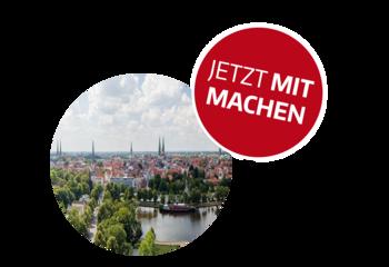 Kreisrundes Foto: Die Silhouette von Lübeck mit den Sieben Türmen - oberhalb rechts ein roter Button mit der Aufschrift: JETZT MITMACHEN - Copyright: Ev.-Luth. Kirchenkreis Lübeck-Lauenburg